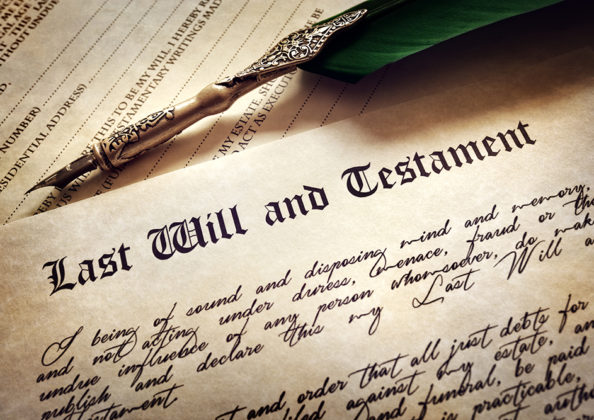 Last Will and Testament document with quill pen and handwriting